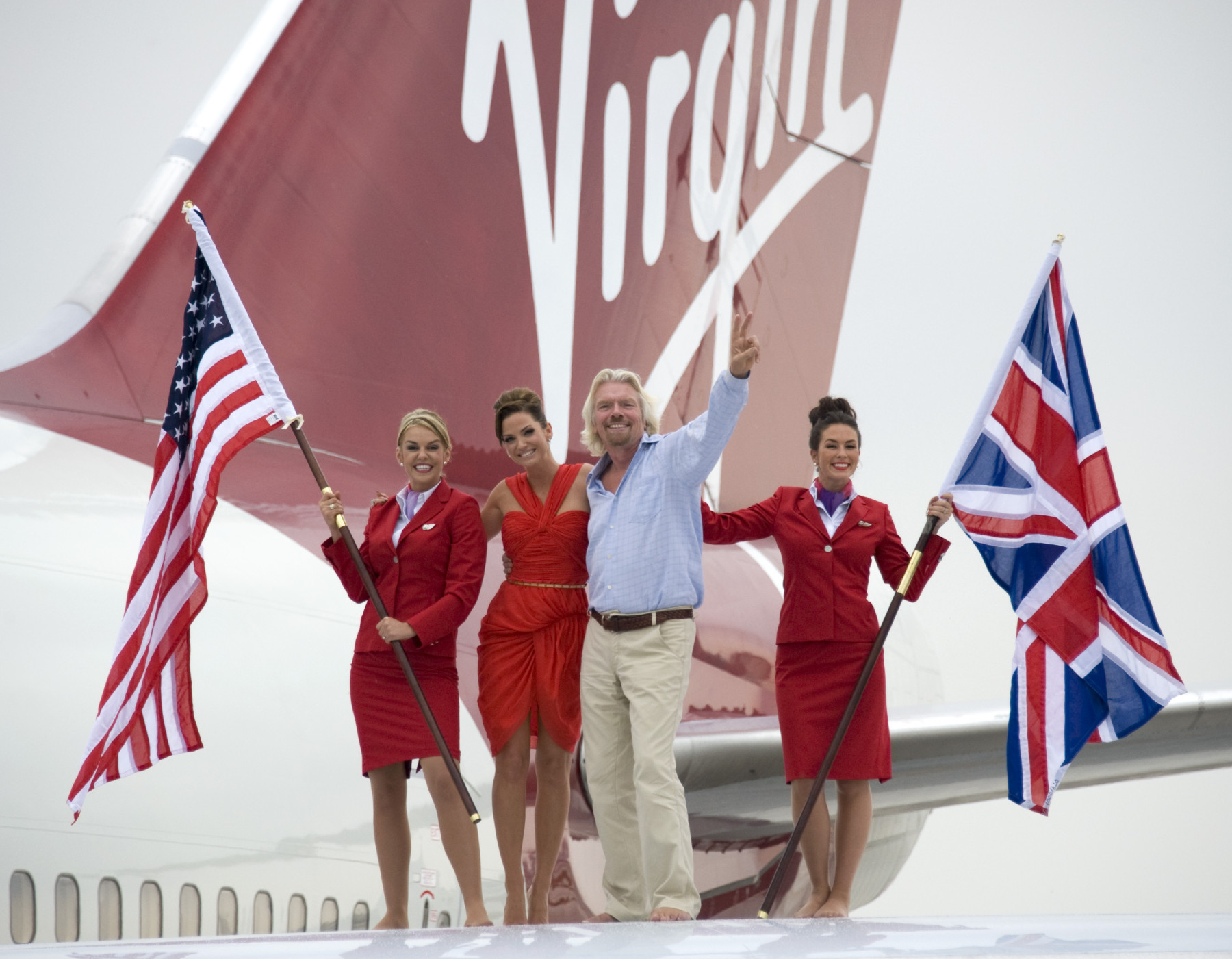 Sir Richard Branson and Sarah Harding at a photocall in Miami celebrate Virgin Atlantic's 25th anniversary to Miami. picture David Dyson
